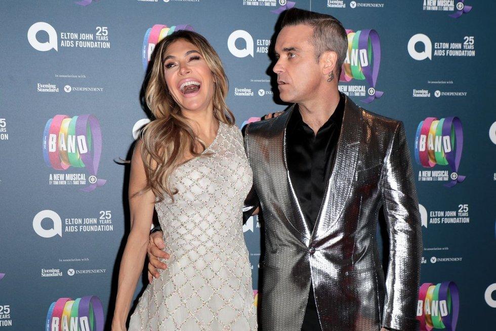 Robbie Williamsas su žmona (nuotr. Vida Press)