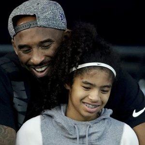 Bryantas su dukra atgulė amžino poilsio: ceremonijoje – tik patys artimiausi