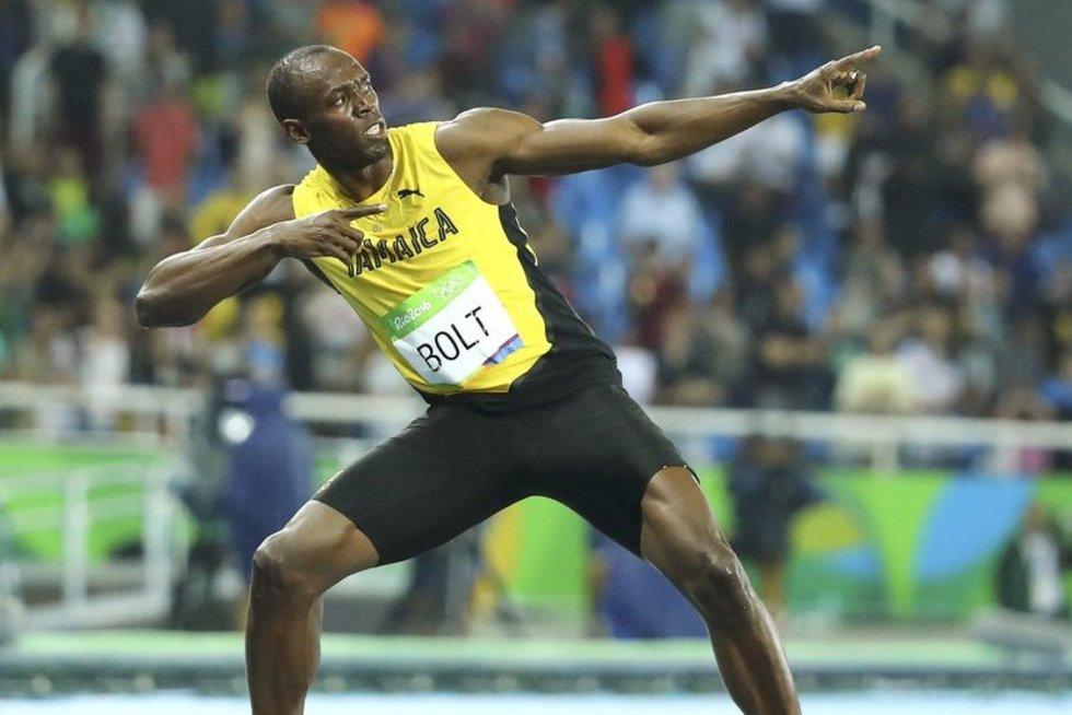 Usainas Boltas laimi 200 metrų bėgimą (nuotr. SCANPIX)