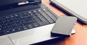 Kompiuteris ir telefonas (nuotr. Fotolia.com)