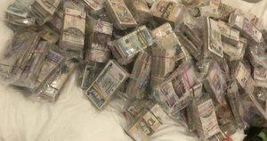 Pinigai (nuotr. stop kadras)
