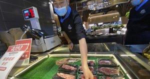 Kinijoje po epidemijos ir potvynių valdžia rekomendavo gyventojams mažiau valgyti (nuotr. SCANPIX)