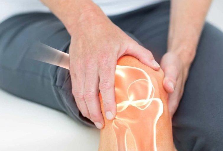 Artritas yra sąnarių uždegimas. Vaizdo reportažo stopkadras.