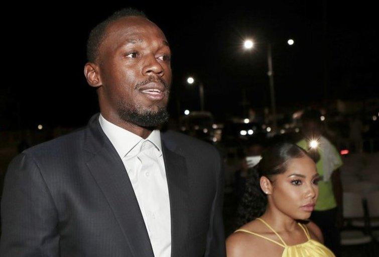 Usain Bolt ir Kasi (nuotr. SCANPIX)