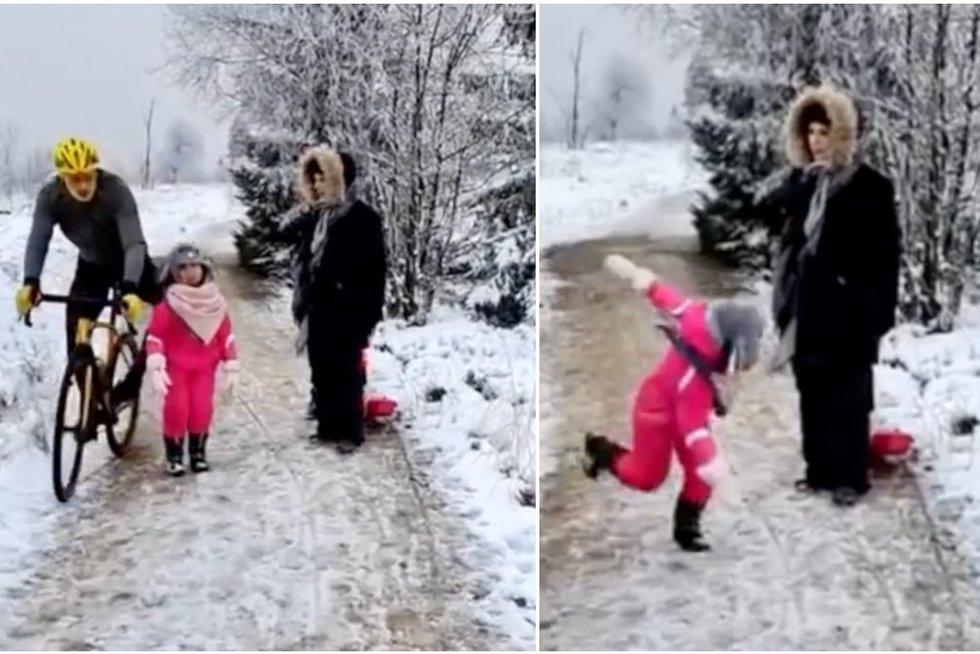 Dviratininko poelgis įsiutino: tyčia pastūmė kelyje pasimaišiusią mergaitę (nuotr. stop kadras)