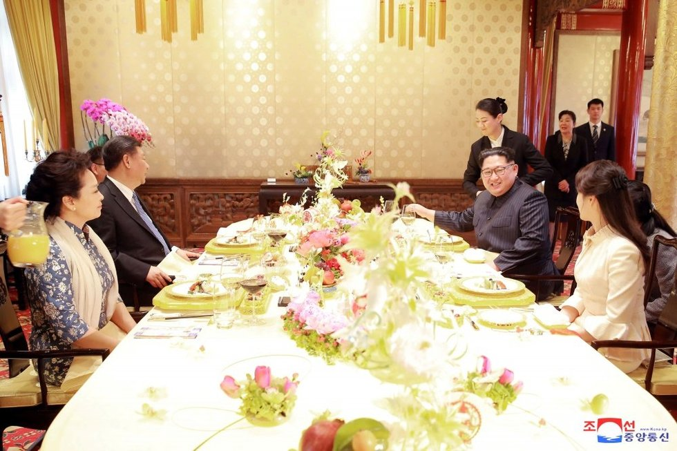 """Kim Jong Uno """"slaptas"""" vizitas: Kinija siunčia aiškią žinią JAV (nuotr. SCANPIX)"""