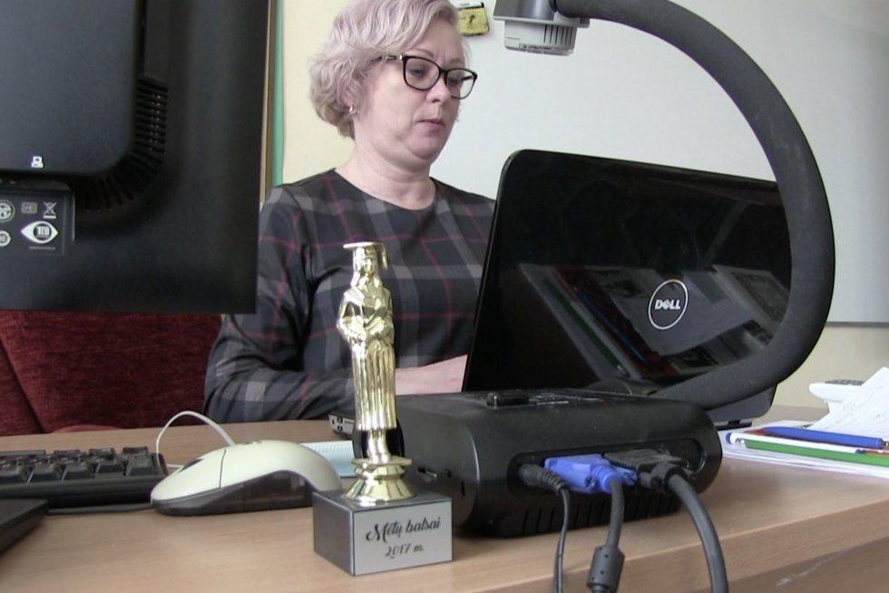 Mokytoja (nuotr. stop kadras)