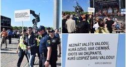 Į Pergalės dieną švenčiančią minią įsiveržė su plakatu apie idiotus ir okupantus: įsikišo policija
