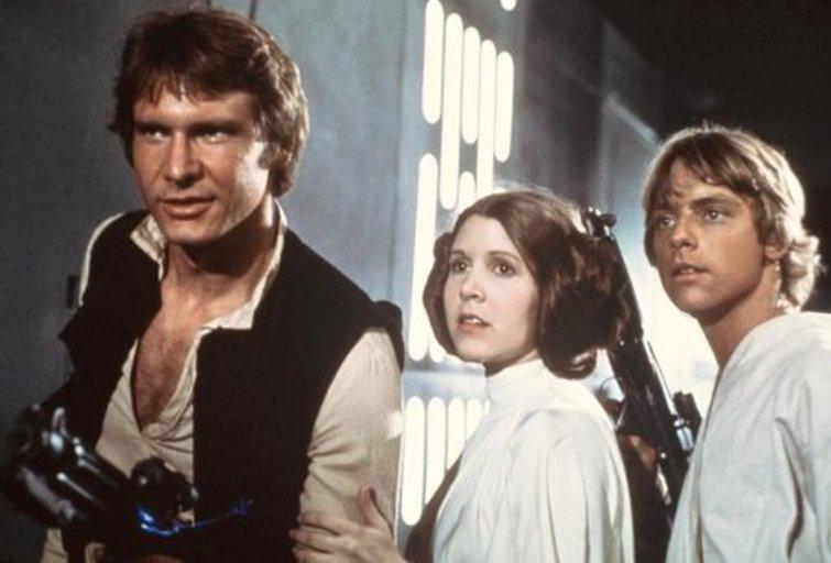 """Harrisonas Fordas, Markas Hamillas ir Carrie Fisher filme """"Žvaigždžių karai"""" (nuotr. iš vaizdo įrašo)"""