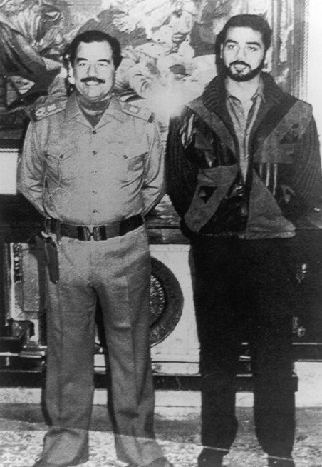 S. Huseinas kartu su sūnumi Udajumi