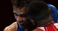 Akibrokštas olimpiniam ringe: marokietis bandė pakartoti Myke'o Tysono manevrą. (nuotr. SCANPIX)