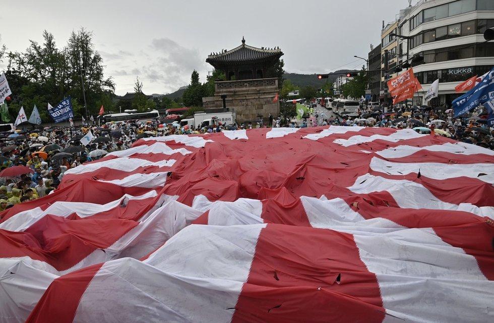 """Kodėl Japonijos """"tekančios saulės"""" vėliava kelia nemažai olimpinių ginčų?"""