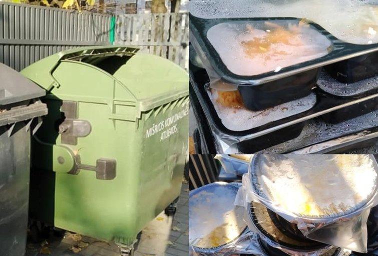 Prie konteinerių – krūva išmesto maisto