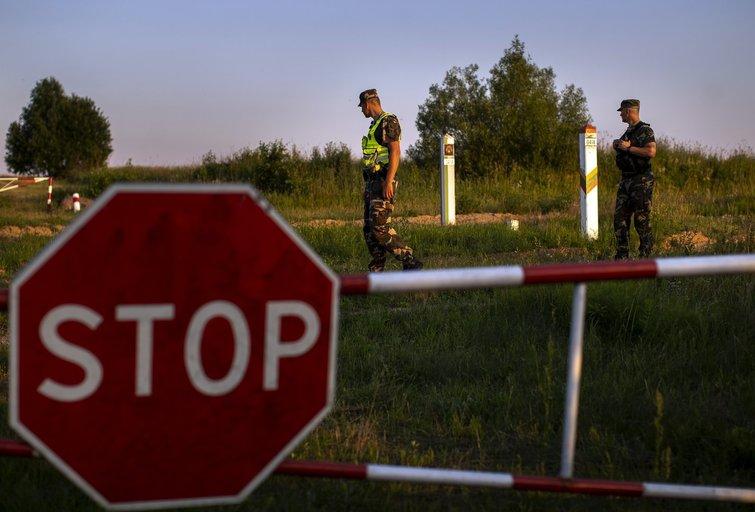 Baltarusijos režimas apkaltino lietuvius sumušus ir per sieną grąžinus migrantus iš Irako (nuotr. SCANPIX)