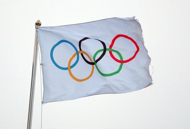 Olimpinė vėliava. (nuotr. SCANPIX)
